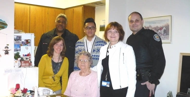 Constable Gary Gomez, Community Relations Officer; Hinson Ho, Registered Dietitian; Constable Dale Nichiporik, Community Relations Officer;  Diane Duncan, Executive Director; Meals On Wheels Client; Amanda Falotico, Director of Care Services;